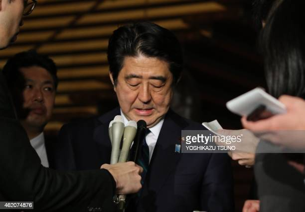 Japanese Prime Minister Shinzo Abe speakes to reporters after a cabinet meeting at his official residence in Tokyo on January 25 2015 Japan's...
