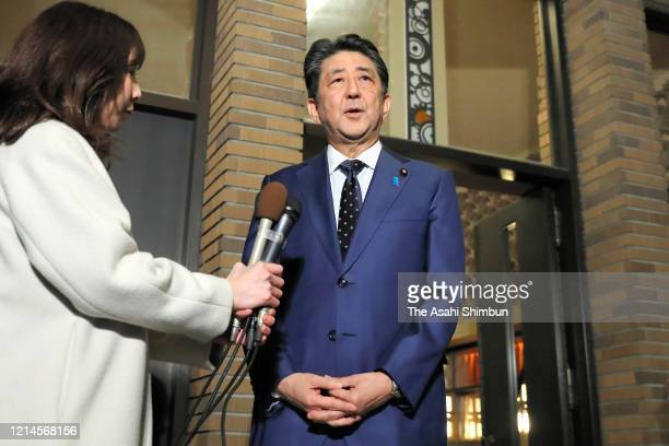 Japanese Prime Minister Shinzo Abe speaks after his teleconference with the IOC President Thomas Bach at the prime minister's official residence on...