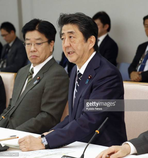 Japanese Prime Minister Shinzo Abe speaks at a meeting of an anticoronavirus task force in Tokyo on March 5 2020 Abe told the meeting Japan will put...
