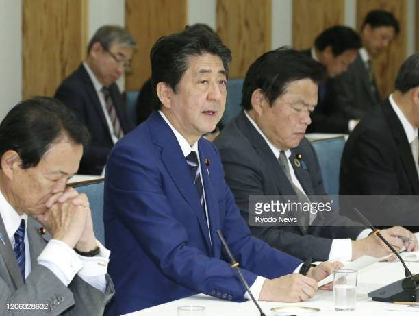 Japanese Prime Minister Shinzo Abe speaks at a meeting of the government and the Liberal Democratic Party-led ruling coalition in Tokyo on March 10...