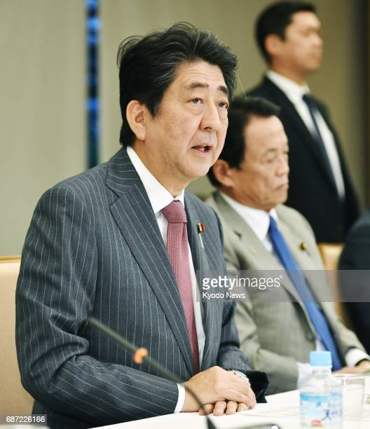 Japanese Prime Minister Shinzo Abe speaks at a meeting of the Council on Economic and Fiscal Policy in Tokyo on May 23 2017 The government proposed...