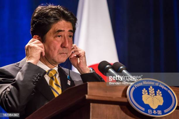 Japanese Prime Minister Shinzo Abe speaks at a news conference on February 22 2013 in Washington DC Abe is in Washington to meet with President Obama...