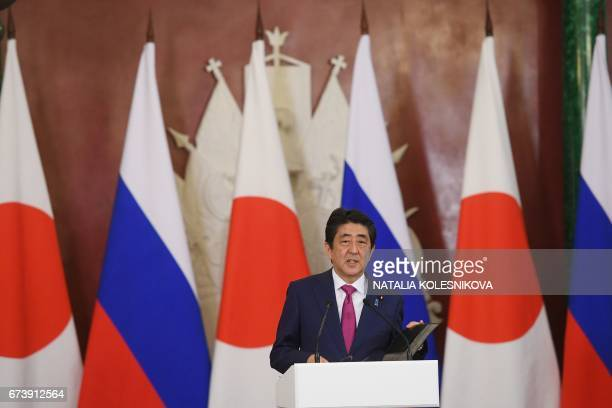 Japanese Prime Minister Shinzo Abe speaks during a joint press conference with Russian President following their meeting at the Kremlin in Moscow on...