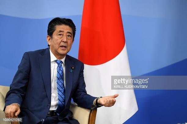 Japanese Prime Minister Shinzo Abe speaks during a meeting with Russian President in Vladivostok on September 10, 2018.