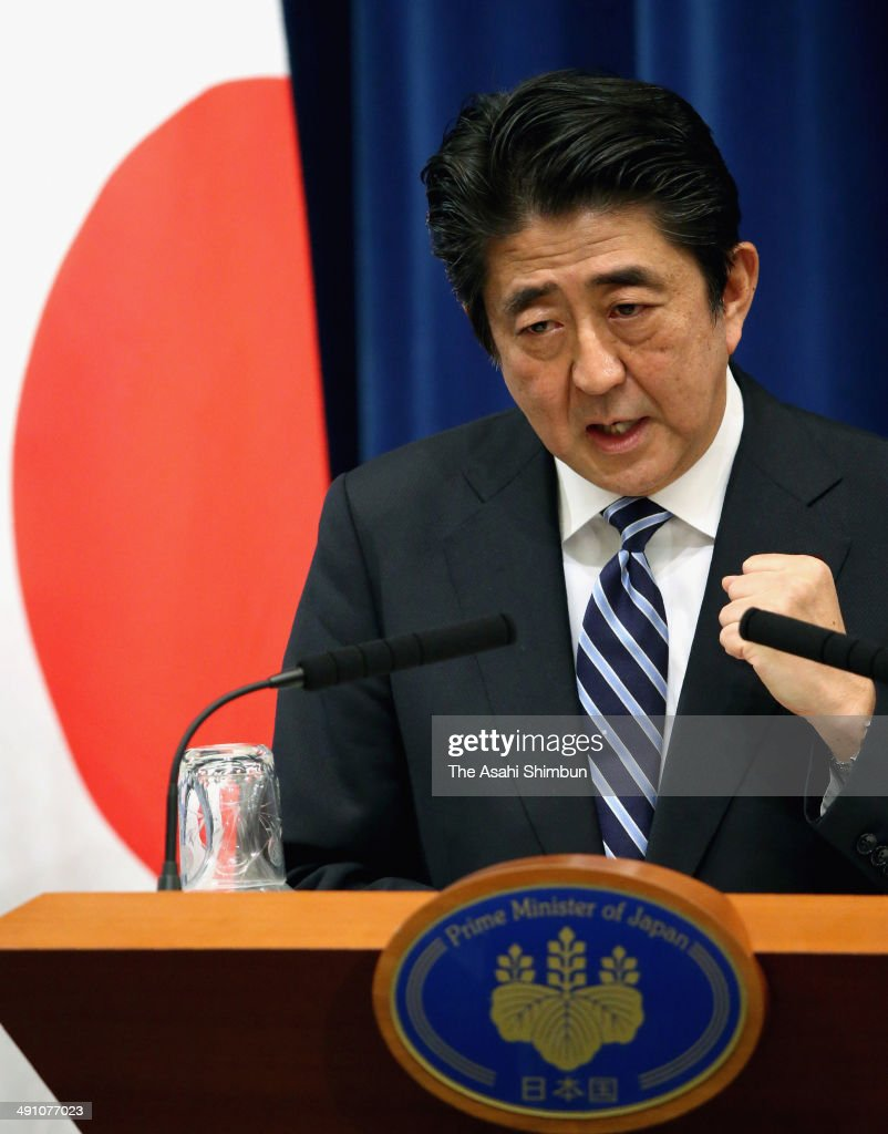 Japanese Prime Minister Shinzo Abe speaks during a news conference on May 15, 2014 in Tokyo, Japan. Abe made clear his government will lift Japanfs self-imposed ban on exercising the right to collective self-defense, saying the change will help to prevent Japan from going to war.