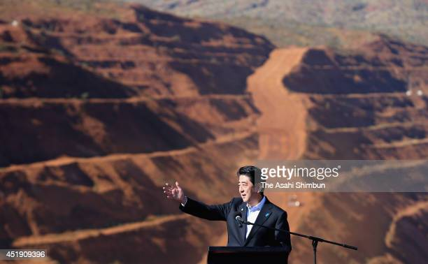 Japanese Prime Minister Shinzo Abe speaks during a tour of the Rio Tinto West Angelas iron ore mine in the Pilbara on July 9 2014 in the Pilbara West...