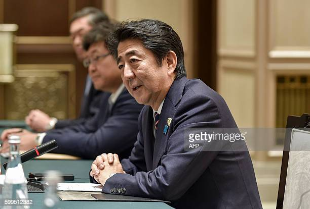 Japanese Prime Minister Shinzo Abe speaks during his meeting with Chinese President Xi Jinping during their meeting at the West Lake State House in...