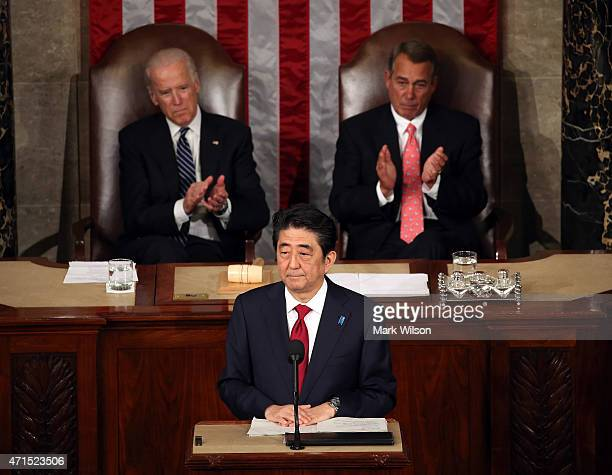 Japanese Prime Minister Shinzo Abe speaks to a joint meeting of the US Congress while flanked by Vice President Joseph Biden and House Speaker John...