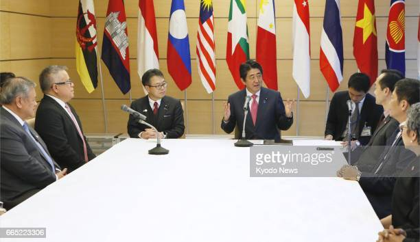 Japanese Prime Minister Shinzo Abe speaks to economic ministers from the 10 member countries of the Association of Southeast Asian Nations at the...