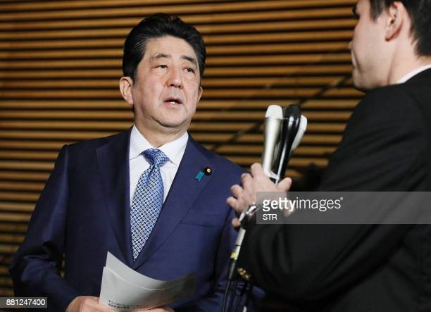Japanese Prime Minister Shinzo Abe speaks to journalists after North Korean missile launch at his official residence in Tokyo on November 29 2017 Abe...