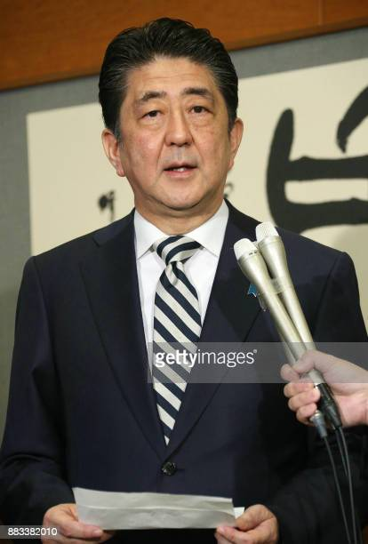 Japanese Prime Minister Shinzo Abe speaks to journalists at his official residence in Tokyo after an Imperial Household Council meeting on December 1...