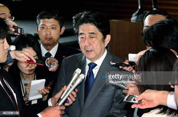 Japanese Prime Minister Shinzo Abe speaks to media reporters after his meeting with state ministers concerning the hostage crisis at his official...