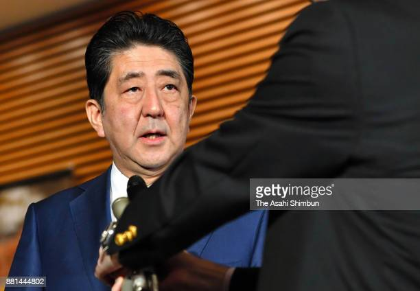 Japanese Prime Minister Shinzo Abe speaks to media reporters after North Korea's missile launch at his official residence on November 29 2017 in...