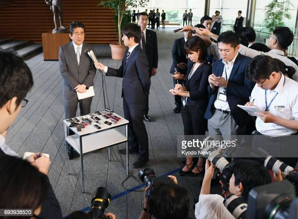 Japanese Prime Minister Shinzo Abe speaks to reporters at his office in Tokyo on June 9 after parliament enacted a law to allow 83yearold Emperor...