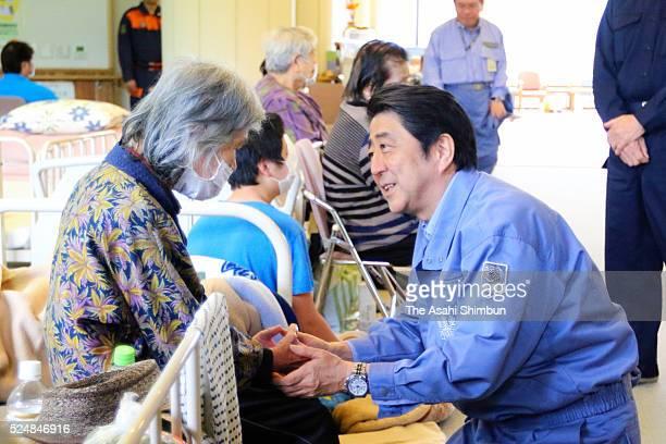 Japanese Prime Minister Shinzo Abe talks to evacuees as he visits an evacuation centre on April 23, 2016 in Minamiaso, Kumamoto, Japan. Southern...