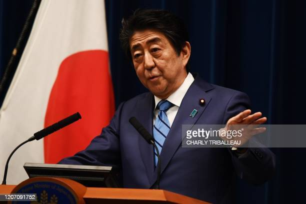 Japanese Prime Minister Shinzo Abe talks to the media during a press conference in Tokyo on March 14, 2020.