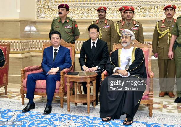 Japanese Prime Minister Shinzo Abe talks with new Sultan Haitham bin Tariq Al Said of Oman during their meeting on January 14, 2020 in Muscat, Oman....
