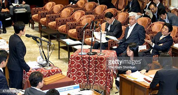 Japanese Prime Minister Shinzo Abe taunts Democratic Party lawmaker Kiyomi Tsujimoto during a special committee to deliberate the 11 security bills...