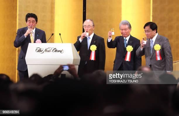 Japanese Prime Minister Shinzo Abe toasts with Japanese business group leaders Akio Mimura Sadayuki Sakakibara and Yoshimitsu Kobayashi during...