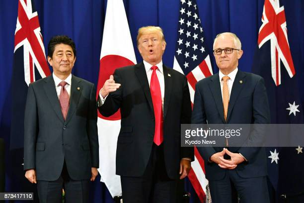 Japanese Prime Minister Shinzo Abe US President Donald Trump and Australian Prime Minister Malcolm Turnbull hold talks in Manila on Nov 13 on the...