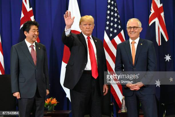 Japanese Prime Minister Shinzo Abe US President Donald Trump and Australian Prime Minister Malcolm Turnbull attend their trilateral meeting on...