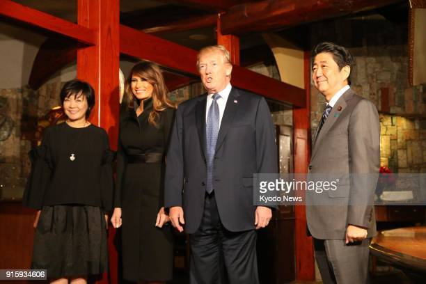 Japanese Prime Minister Shinzo Abe US President Donald Trump his wife Melania and Abe's wife Akie pose for photos before dinner at UkaiTei restaurant...