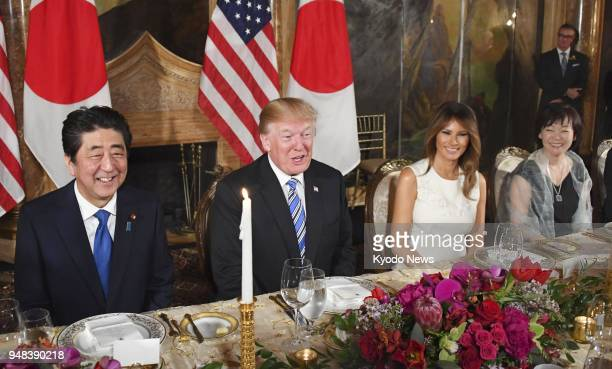 Japanese Prime Minister Shinzo Abe US President Donald Trump his wife Melania Trump and Abe's wife Akie attend a dinner reception in Palm Beach...