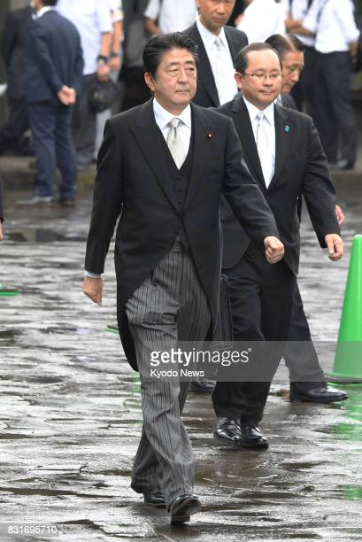 Japanese Prime Minister Shinzo Abe visits the Chidorigafuchi National Cemetery in Tokyo to offer flowers on Aug 15 the 72nd anniversary of the end of...