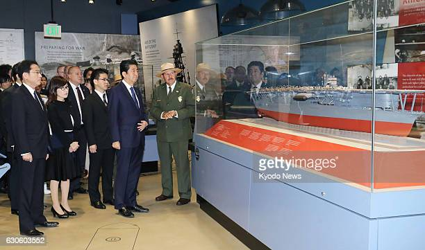 Japanese Prime Minister Shinzo Abe visits USS Arizona Memorial Visitor Center in Hawaii on Dec 27 2016 At Pearl Harbor Abe together with US President...
