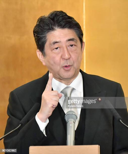 Japanese Prime Minister Shinzo Abe vows at a New Year press conference in Ise Mie Prefecture on Jan 4 to work with the international community and...