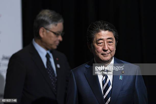 Japanese Prime Minister Shinzo Abe walks off stage after delivering the keynote speech at the Japan National Tourism Organisation Seminar at the...