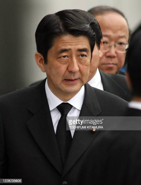 Japanese Prime Minister Shinzo Abe walks to meet with journalists after attending the Hiroshima Peace Memorial Ceremony in Hiroshima 06 August 2007...