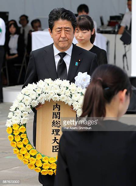 Japanese Prime Minister Shinzo Abe walks to offer a wreath during the memorial ceremony on the 71st anniversary of the atomic bomb dropping at the...