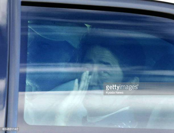 Japanese Prime Minister Shinzo Abe waves from a car after playing golf with US President Donald Trump in Florida on Feb 11 2017
