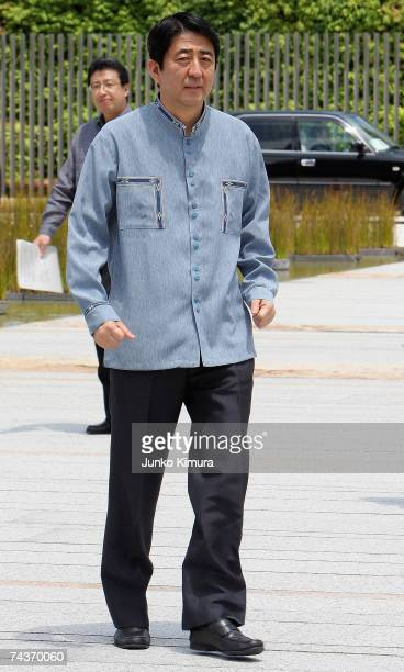 Japanese Prime Minister Shinzo Abe wearing an Okinawan ''Kariyushi'' casual shirt arrives at the Prime Minister's official residence June 1 2007 in...