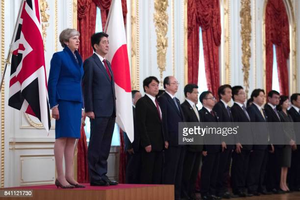 Japanese Prime Minister Shinzo Abe welcomes British Prime Minister Theresa May to the Akasaka Guest House in Tokyo where they attended an official...