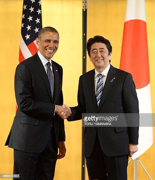 Japanese Prime Minister Shinzo Abe welcomes US President Barack Obama prior to their talks at the Akasaka guesthouse in Tokyo on April 24 2014 Barack...