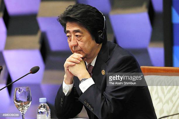 Japanese Prime Minister Shinzo Abe xxx a plenary session of the Asia Pacific Economic Cooperation on November 19, 2015 in Manila, Philippines....