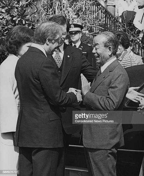 Japanese Prime Minister Takeo Fukuda is greeted by US President Jimmy Carter upon his arrival at the White House in Washington DC 21st March 1977...