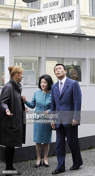 Japanese Prime Minister Taro Aso and his wife Chikako Aso speak to Alexandra Hildebrandt director of the House at Checkpoint Charlie Museum as they...