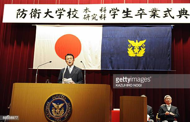 Japanese Prime Minister Taro Aso delivers a speech during the graduation ceremony for cadets at the National Defense Academy in Yokosuka Kanagawa...