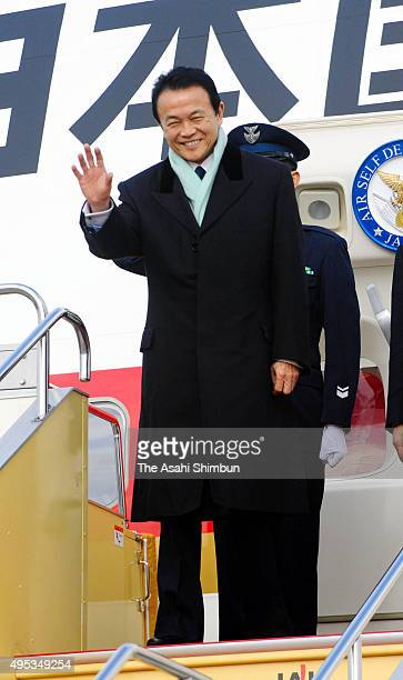 Japanese Prime Minister Taro Aso is seen on arrival at Fukuoka Airport to attend the JapanChinaSouth Korea trilateral summit at the Kyushu National...