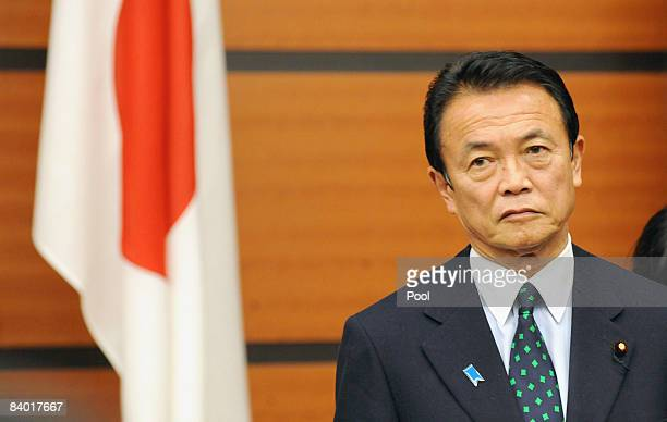 Japanese Prime Minister Taro Aso prior to a photo session with Chinese Premier Wen Jiabao and South Korean President Lee Myung Bak , prior to a...