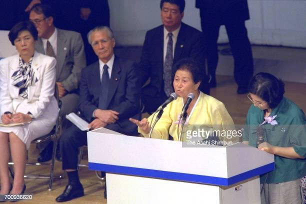 Japanese Prime Minister Tomiichi Murayama and Lower House speaker Takako Doi listen to a South Korean 'comfort woman' on the 50th anniversary of the...