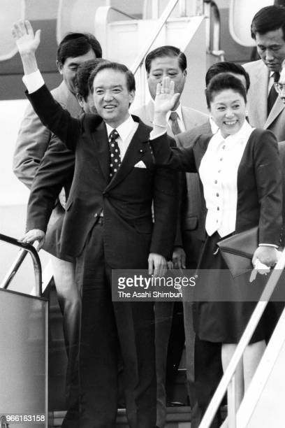 Japanese Prime Minister Toshiki Kaifu and his wife Sachiyo wave on departure for the United States at Haneda Airport on August 30 1989 in Tokyo Japan