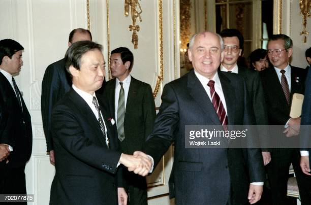 Japanese Prime Minister Toshiki Kaifu and President of the Soviet Union Mikhail Gorbachev shake hands during Gorbachev's visit to Tokyo Japan on 17th...