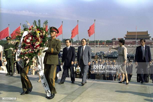Japanese Prime Minister Toshiki Kaifu offers a wreath at the Monument to the People's Heroes at Tiananmen Square on August 11 1991 in Beijing China