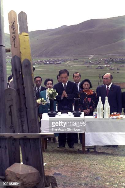 Japanese Prime Minister Toshiki Kaifu prays for detainees at the Japanese cemetery on August 13 1991 in Ulan Bator Mongolia