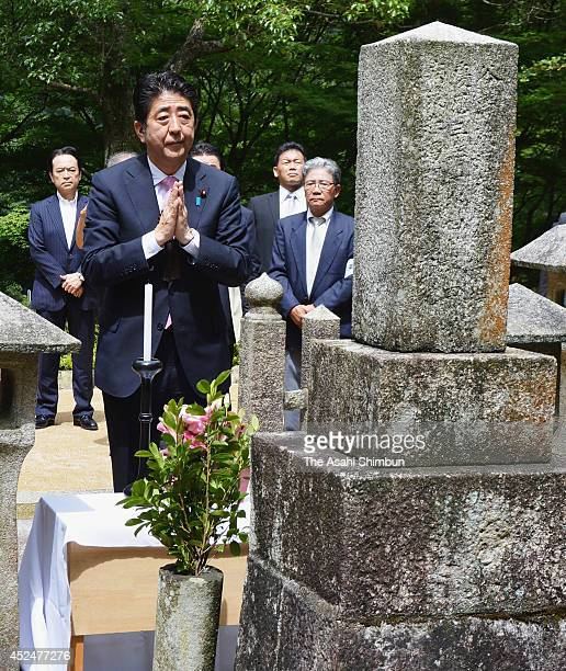 Japanese Prime Minister visits the grave of Shinsaku Takasugi during his visit to Yamaguchi on July 14 2014 in Shimonoseki Yamaguchi Japan
