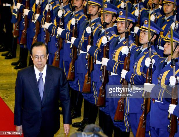 Japanese Prime Minister Yasuo Fukuda inspects the guard of honor during a welcoming ceremony at the Great Hall of the People in Beijing 28 December...